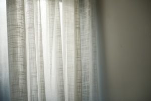 drapes against window.